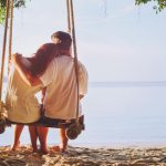 romantic-holidays-honeymoon-affectionate-couple-on-beach-on-swing